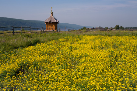 remake: Wooden Orthodox chapel on the outskirts of the village. Lena river. Yakutia. Stock Photo