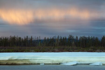 expressive: River frazil on the background of an expressive sky. Moma River. Yakutia. Russia.