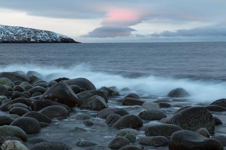 gloom: Rounded stones on the seashore. Barents Sea. Murmansk region. Russia. Stock Photo