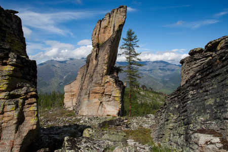 erect: Granite outlier in the mountains. Yakutia. Oimyakon area. Russia.