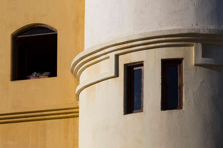 roundish: Windows on the facade of the building. El Gouna. Egypt.