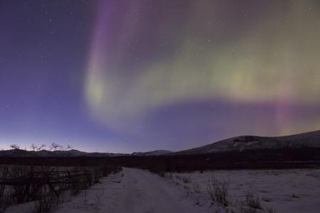 merry dancers: Aurora in the sky Yakutia. Moma district. Yakutia. Russia. Stock Photo
