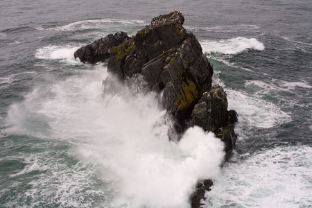 beating: Powerful wave beating against the cliffs into the sea.