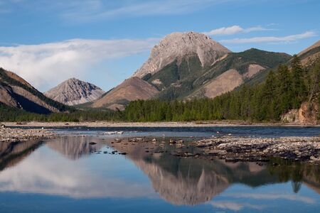 expressive: Mountain expressive form and its reflection in the river. River Omulyovka. Magadan Region. Russia.