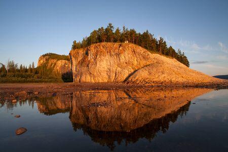 lena: The rocky shore of the river, in the light of the setting sun. Lena river. Yakutia. Russia. Stock Photo