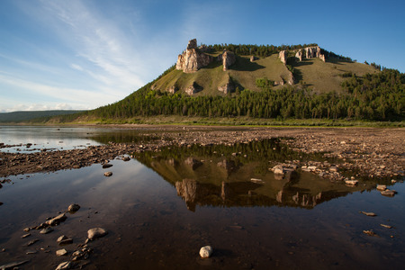 lena: Mount with rocks and reflections in the river. Lena river. Yakutia. Russia.