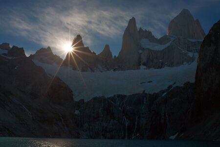 over the edge: Sunset over the edge of a cliff. Patagonia. Fitzroy. Argentina. Stock Photo