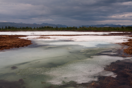 remnants: Remnants of ice in the river valley. Moma River. Yakutia. Russia.