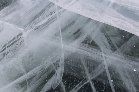 methane: A thick layer of ice in the cracks and bubbles of gas. Lake in Yakutia. Russia. Stock Photo
