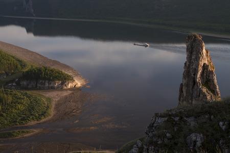 grandiose: Top view of a big river and a floating vessel. Lena river. Yakutia. Russia.