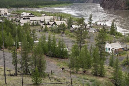 diggers: Deserted village diggers on the banks of the river. Village Predporozhny. Indigirka River. Yakutia. Russia. Stock Photo