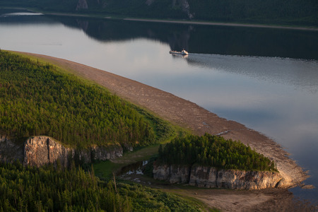 lena: Top view of a big river and a floating vessel. Lena river. Yakutia. Russia.