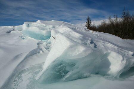 hummock: Blocks of ice under the snow. Moma Mountains. Yakutia. Russia.