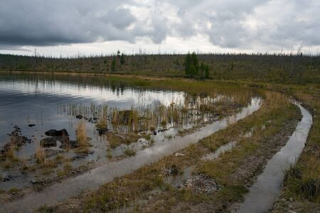 along: Track under the water along the shore of the lake. Lake Labynkyr. Yakutia. Russia.