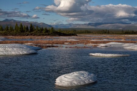 remains: Remains of the ice in the river valley after the winter. Moma River. Yakutia. Russia. Stock Photo