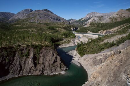 abrupt: The river in the canyon with green water. River Omulevka. Yakutia. Russia.