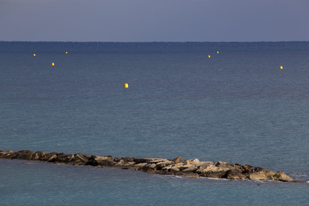 buoys: The pier and buoys at sea. Limassols seafront promenade. Cyprus.