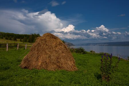ample: Haystack on a background of the river. Lena river. Yakutia. Russia.