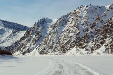 Winter road on ice mountain river. Uyandina River. Yakutia. Russia.