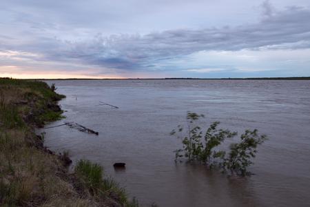 muddy: Big river overflowing with muddy water. Indigirka River. Yakutia. Russia.