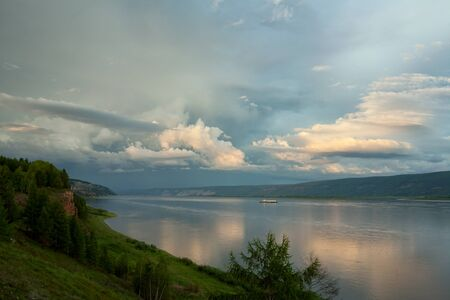 ample: Beautiful clouds over a large river. Lena river. Yakutia. Russia. Stock Photo