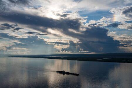along: Barge floating along the big river. Lena river. Yakutia. Russia.