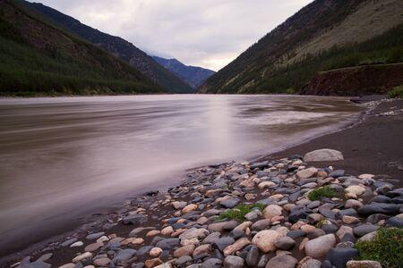muddy: Muddy mountain river with long exposure. Indigirka River. Yakutia. Russia. Stock Photo