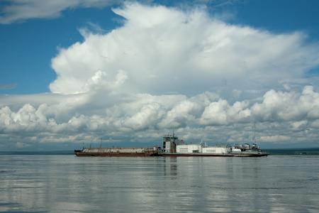 Oil tanker on the big river. Lena river. Yakutia. Russia.
