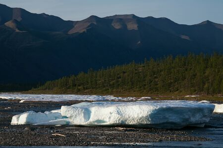 chunks: Chunks of ice in the river valley. River Eyemyu. Moma Mountains. Yakutia. Russia. Stock Photo