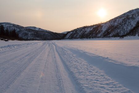 snowcovered: Snow-covered road on the river bed. Yakutia. Russia. Stock Photo