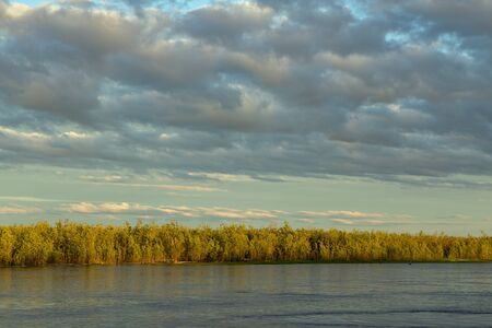 equipoise: The coastline to the wood between the sky and the river. Indigirka River. Yakutia. Russia.