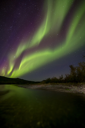 radiacion solar: Aurora Borealis over the river. River Paypudyna. Polar Urals. Russia.