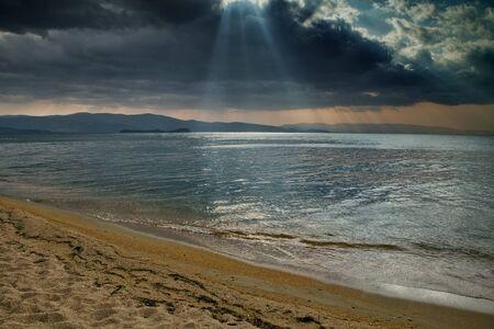 glimmering: A beam of sunlight falling on the surface of the lake. Lake Baikal. Buryatia. Russia.