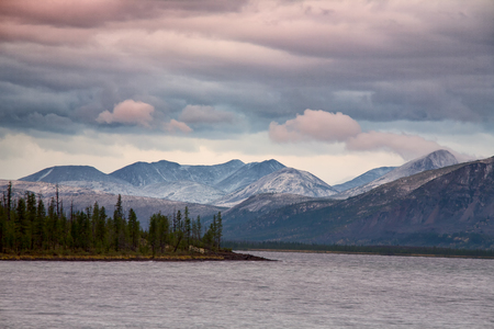 Clouds over the mountains and big lake. Lake Labynkyr. Yakutia. Russia. Stock Photo
