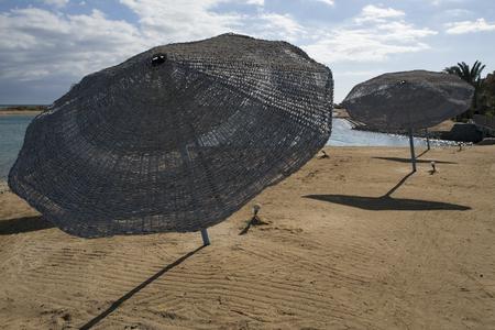 lean out: Falling umbrellas backlit by the sea. El Gouna. Egypt