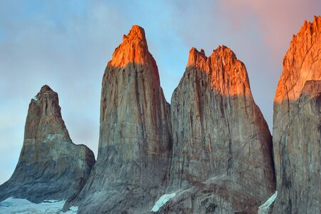 plumb: Meeting sunrise at the towers of Torres. National Park Torres del Paine. Patagonia. Chile.
