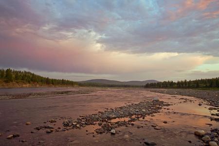 Sunset on the rocky river. River Omulevka, Magadan region Stock Photo