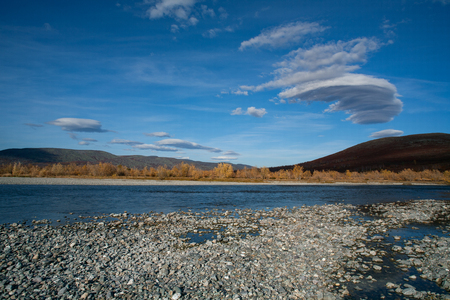 lenticular: Lenticular clouds over autumn river. River Paypudina. Polar Urals. Russia. Stock Photo