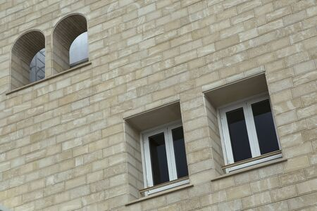 Paired windows in a brick building. Limassol. Cyprus.