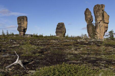 Detached granite rocks of unusual shape on the dais. Ridge Ulakhan-Sis. Yakutia. Russia. Reklamní fotografie
