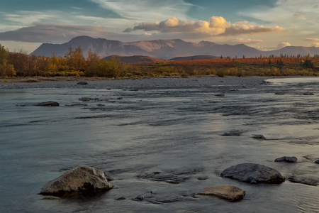 downstream: The river and the mountains beyond at sunset. Polar Urals. Russia. Stock Photo