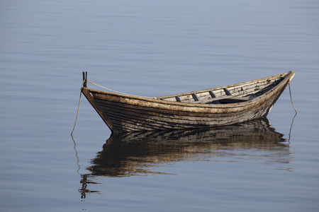 Wooden boat on the calm surface of the lake. Chivyrkuisky Bay. The Lake Baikal. Buryatia. Russia. Stok Fotoğraf