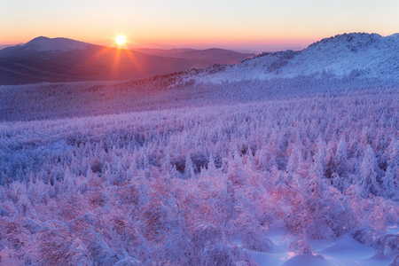 Snowy winter landscape in the mountains. National Park Taganay. Southern Urals. Russia.