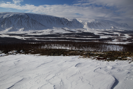 River valley in the snowy mountains. The River Sob. Polar Urals. Russia.