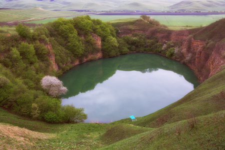 The lake is karst origin. Lake Shadhurey. North Caucasus. Stock Photo