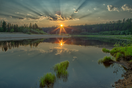 Sunrise over the taiga river. Natural Park Siine. Yakutia