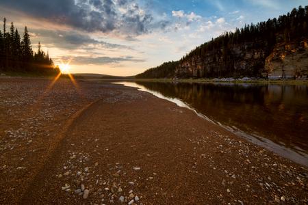 Sunset over boreal river and sandy . The River Amga. Yakutia. Stock Photo