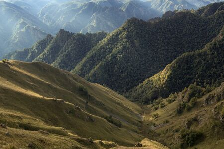 Bizarre mountainous landscape filmed against the light. Karachay-Cherkessia. North Caucasus.