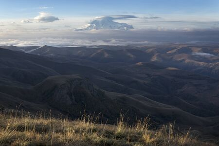 View of the summit of mount Elbrus with the edge of the plateau. Plateau Bermamyt. North Caucasus.