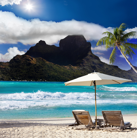 View of the mountain ,beach chairs and sea.
